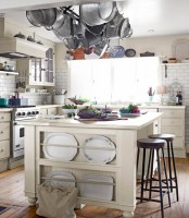 a kitchen island with a side plate storage space and a holder for pots and pants over the kitchen island for maximal functionality