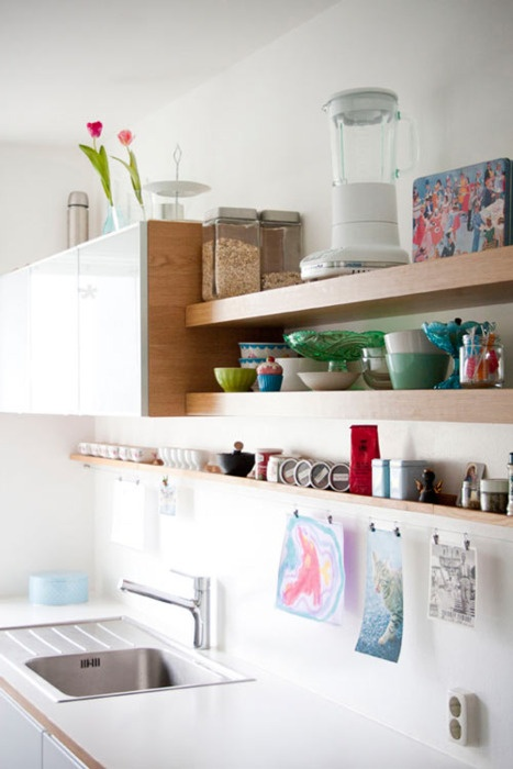 upper cabinets united with some open shelves are great for storing everything you want and they won't look as bulky as just uppers
