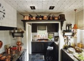 a large rack over the doorway is a cool way to make the use of that awkward space over the door