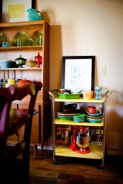an open shelving unit and a kitchen cart, which is a great idea for open storage