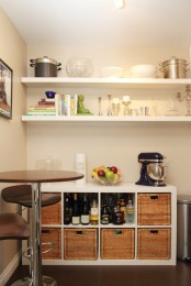open shelving is always a good idea and you can pair it with a kitchen island with lots of woven drawers for storage