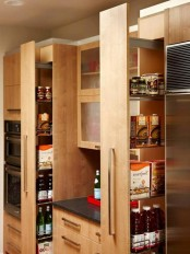 lots of vertical and usual drawers and glass cabinets will give you much storage space for all your kitchen stuff