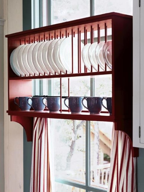a creative rack with a plate stand and a shelf for cups is a cool idea for any kitchen