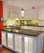 a large kitchen island with storage space and built-in lights plus fridges for storing wine and other alcohol