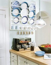 a rack holding the plates and mugs, with hooks to hang more cups is a cool way to store and display your tableware