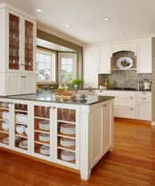a storage kitchen island with glass doors to store all kinds of tableware and mugs is a smart idea