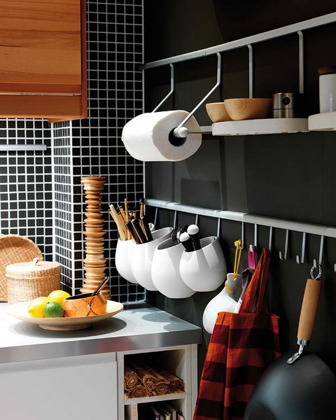 a wall-mounted metal holder with two tiers and shelves, with holders for various stuff and utensil holders