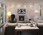 an elegant and refined living room with a whitewashed brick statement wall that adds a casual feel