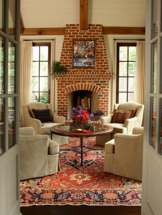a traditional living room done with a fireplace of red brick for maximal coziness and a vintage feel