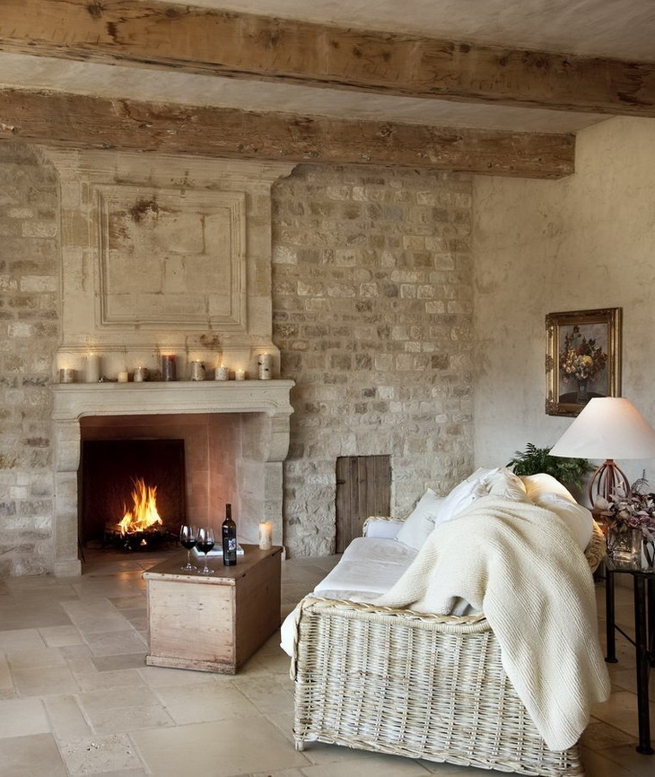 a French farmhouse living room with a statement white brick wall and a built in fireplace