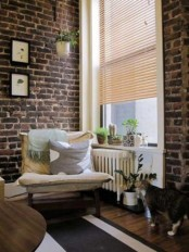 original dark brick walls are highlighted with white grout and bring much texture inside