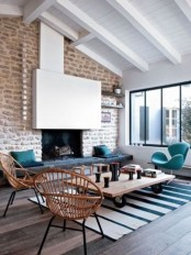 a contemporary living room with a whitewashed statement brick wall, bright and rattan furniture