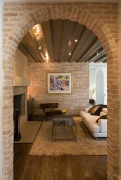 red brick walls were whitewashed to achieve a more neutral and muted look for the space
