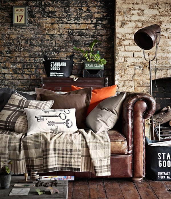 a combo of light colored and dark colored brick makes the living room textural and catchy giving it a masculine feel