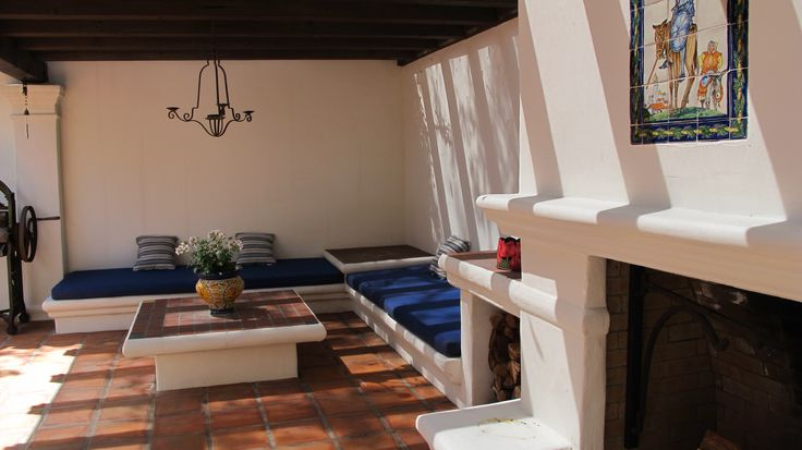 an outdoor relax zone with an L shaped seating with upholstery and a low coffee table