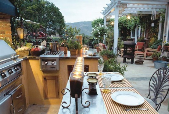 a stylish outdoor grill zone of concrete, with a grill, a small cooker and some cooking space plus a meal space