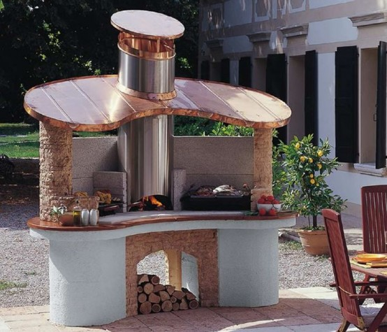 an outdoor grill and pizza oven plus some cooking space in one unit for a cool outdoor bbq space