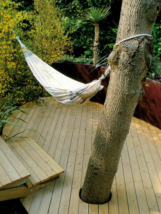 a small and simple deck with a hammock and steps - who needs more to relax