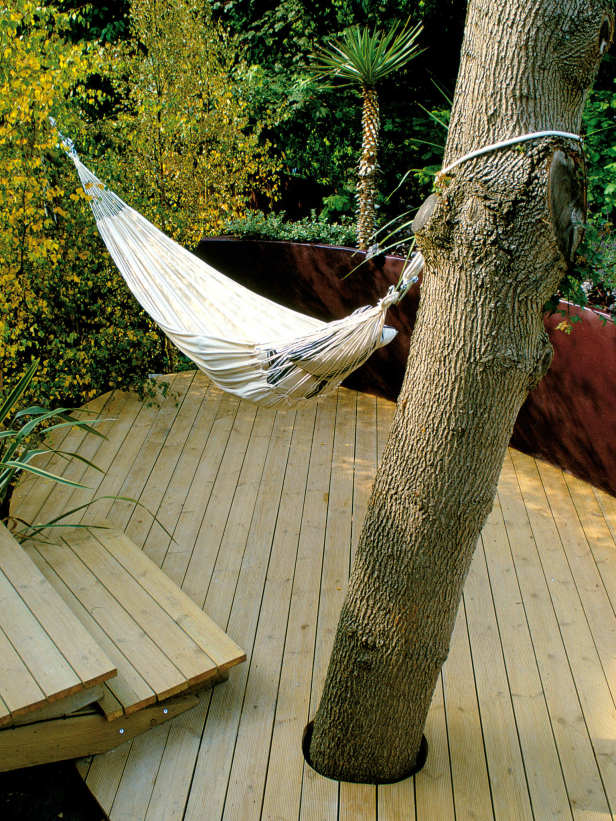 a small and simple deck with a hammock and steps   who needs more to relax
