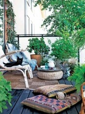 a Scandinavian deck with wooden furniture, jute ottomans and rugs and potted greenery