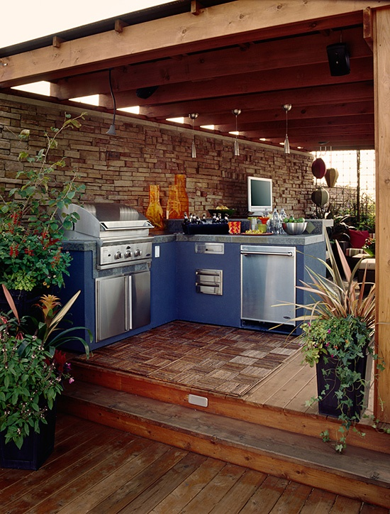 installing an outdoor kitchen on a deck with a view is a great way to