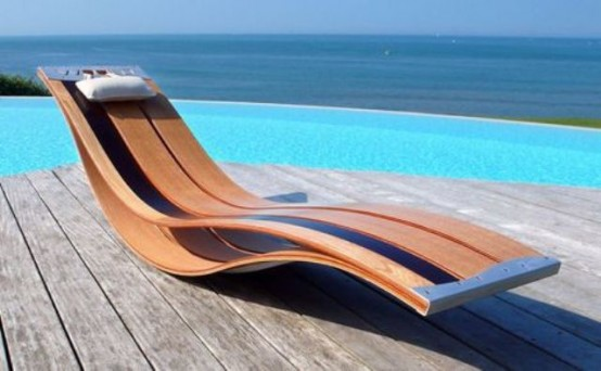 a statement contemporary plywood lounger with a very smooth shape and with some metal touches is a cool idea for a minimalist space