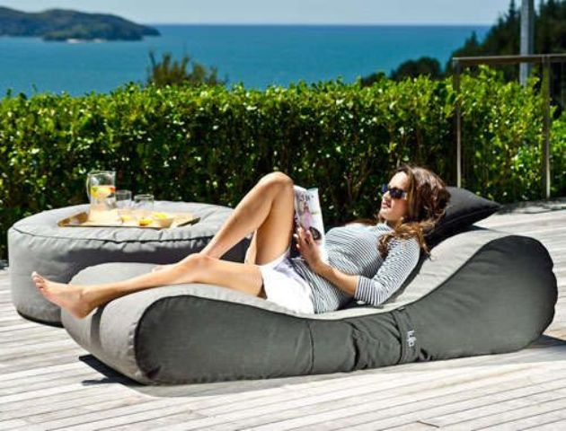 a soft grey upholstered lounger with a matching ottoman is an ideal piece for a minimalist or contemporary space