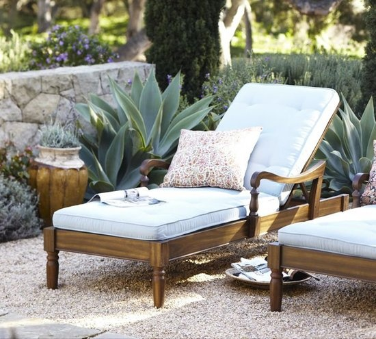an elegant vintage-inspired dark stained wooden lounger with light blue upholstery, pillows is a chic idea for any space where you want a touch of vintage charm