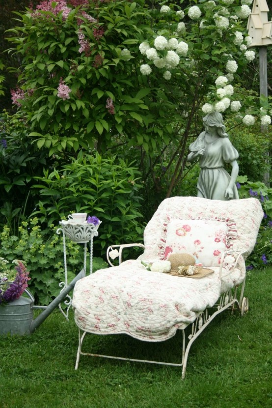 an elegant white lounger with vignettes and other decor and floral upholstery is a very chic idea for a vintage or shabby chic space