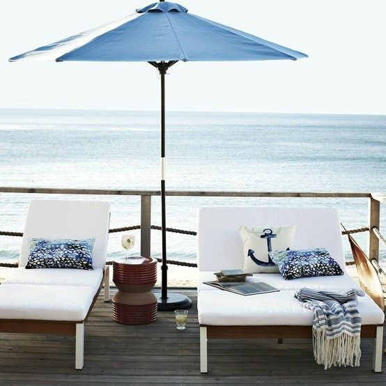 elegant wood and plywood lounger and double lounger with white upholstery are perfect for a contemporary coastal or beach space