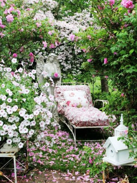 an elegant white metal lounger with bright floral upholstery and pillows is ideal for spring and summer outdoor spaces in vintage style