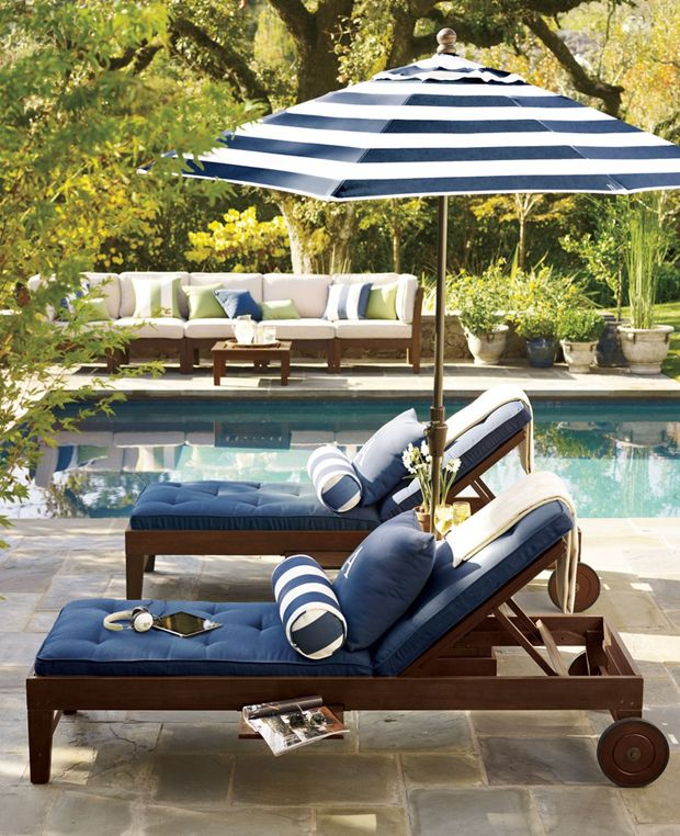 chic modern dark wooden loungers with casters and blue upholstery look stylish and casters make them easy to move wherever you need them