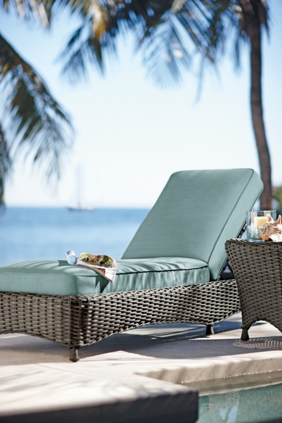 a classic dark wicker lounger with green upholstery is a nice idea for manu backyards and various outdoor spaces