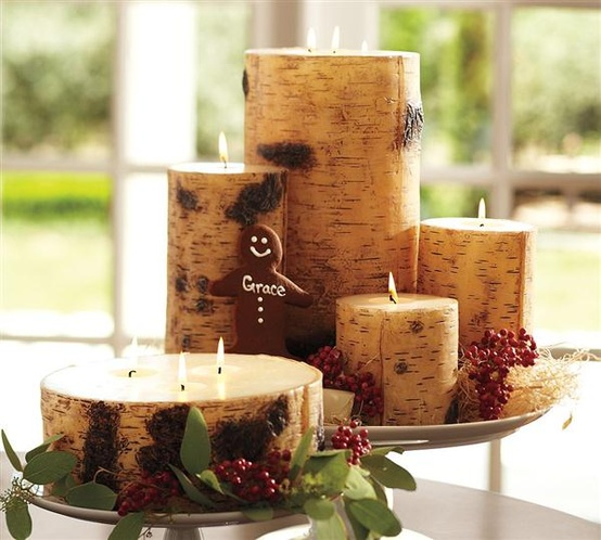 candles wrapped with wood bark and placed on plates to form cool rustic Christmas centerpieces or decorations