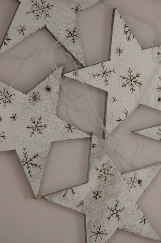 white wooden star ornaments with wood burnt snowflakes are amazing for cozy Christmas decor