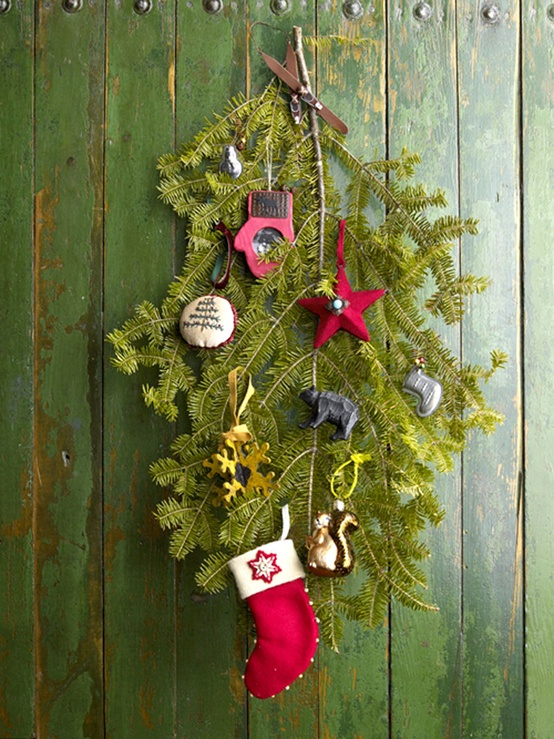 a rustic decoration of evergreens and metallic and red whimsy Christmas ornaments plus a mini stocking