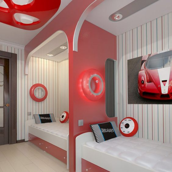 a stylish modern teen boy bedroom with striped walls, beds in niches, storage drawers and bright touches of red