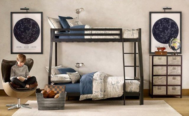 a stylish shared teen boy bedroom with a black bunk bed, a map covered cabinet, sky maps on the walls and comfy chairs