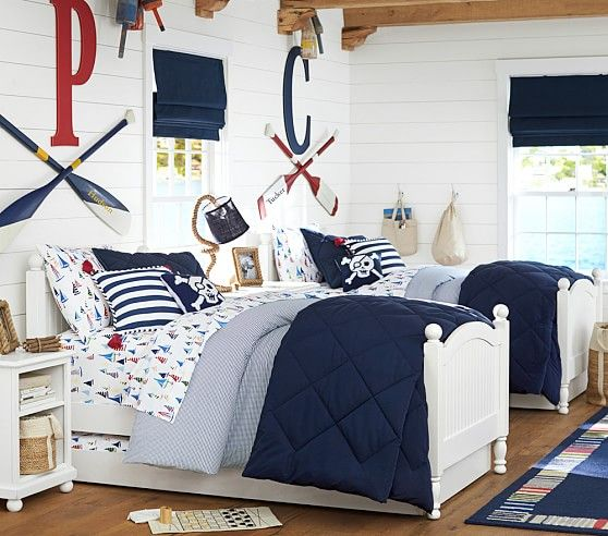 a nautical shared teen boy bedroom with white walls, oars and monograms plus nautical bedding