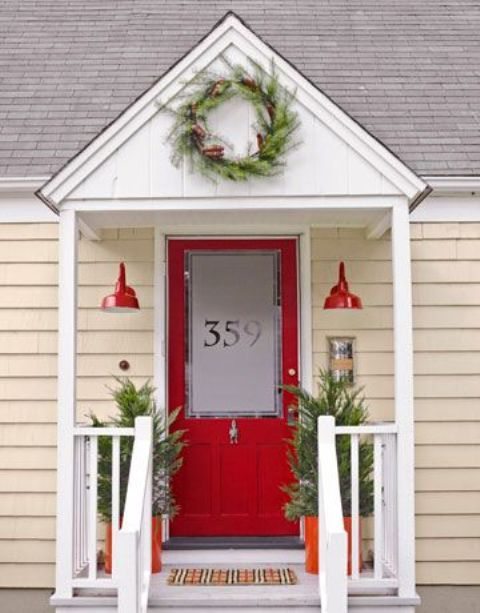 If your front door is red then you might want to get light fixtures and planters in the same color.