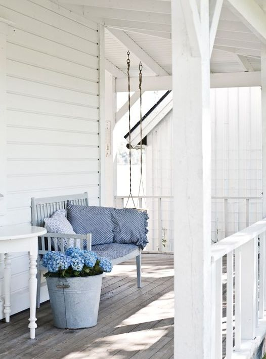 White is the best color to make your front porch looks bigger than it is.