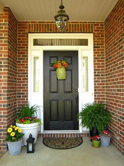 you can not only grow flowers in planters but also put them in a door wreath - Porch Designs Ideas