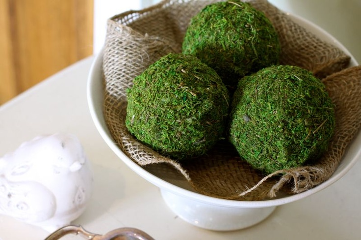 a bowl with burlap and moss balls is a cool centerpiece idea for spring, it feels rustic
