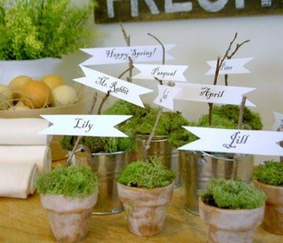 pots with moss and cards on twigs will do nice place cards with a strong springy feel