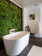 a living moss wall in your bathroom will make it feel outdoorsy during any season of the year, and it's a trendy decor feature
