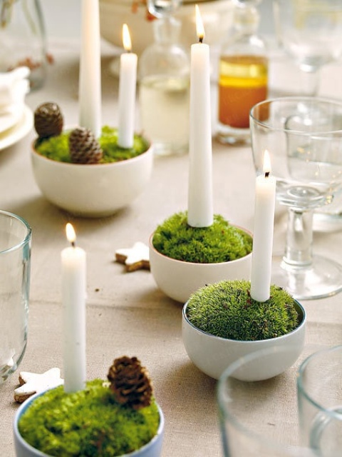 cups with moss and candles plus pinecones for a cool sprign centerpiece or decor with a woodland feel