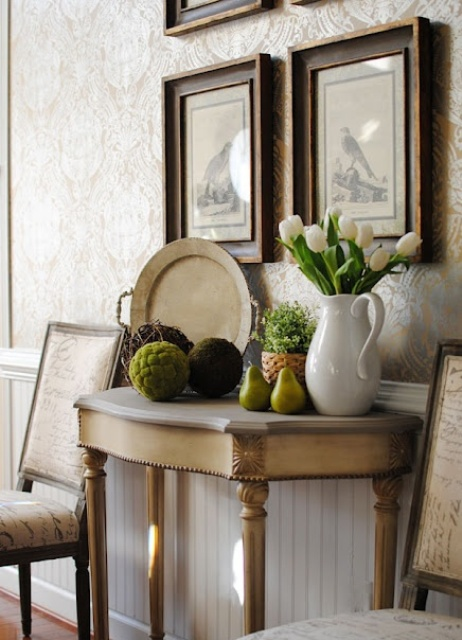 moss balls on console tables are right what you need for adding a spring feel to the space