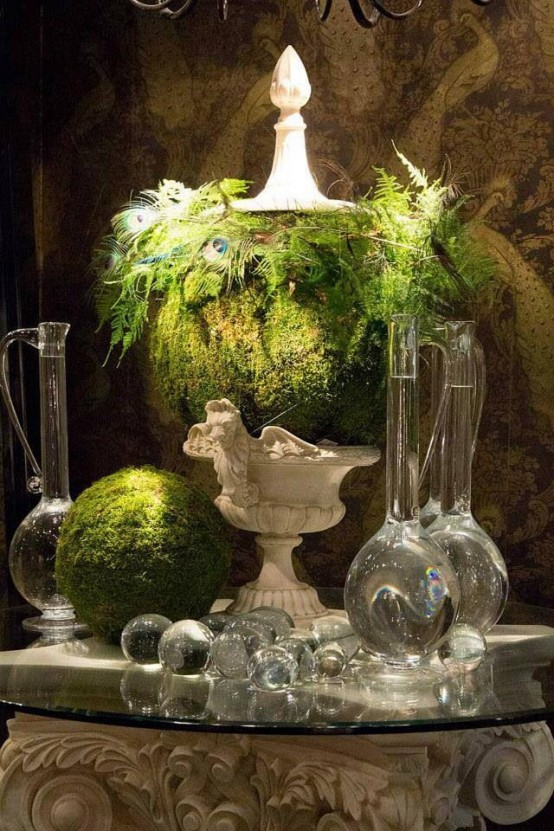 a quirky centerpiece of a vintage urn, a moss ball, some greenery and a moss ball next to it for a spring wedding