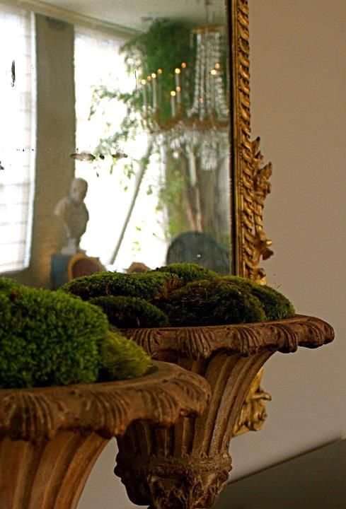 large vintage urns with moss balls look very rustic and very chic adding a natural feel to your home