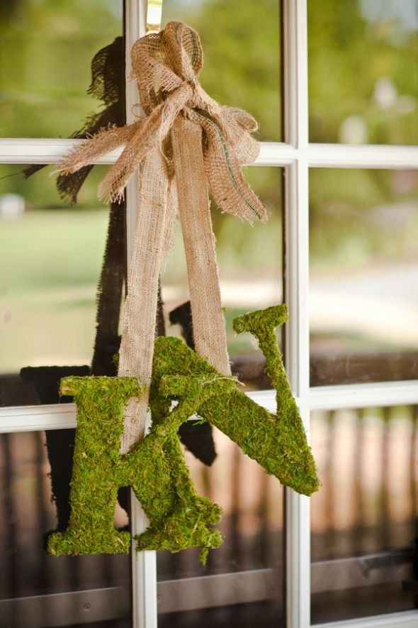 hang some moss monograms on burlap ribbons instead of usual wreaths on your front door